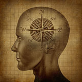 Moral Compass. And career path concept with a human head and a compass as a brain on a grunge old parchment texture as a concept of knowing what direction to Royalty Free Stock Photography