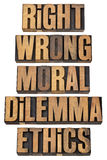 Moral dilemma concept. Right, wrong, moral dilemma, ethics - ethical choice concept - a collage of isolated words in vintage letterpress wood type Royalty Free Stock Photography