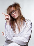 Moral scientist shaggy woman. On gray background Royalty Free Stock Photo