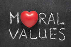 Moral values heart. Moral values phrase handwritten on blackboard with heart symbol instead O stock image