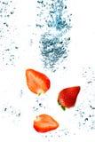 A morango está caindo Imagens de Stock