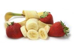 Morangos e bananas Imagem de Stock
