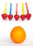 Morangos e laranja Imagens de Stock Royalty Free