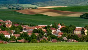 Moravian old village with meadow fields in the summer time