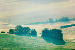 Moravian rolling fields in morning mist Royalty Free Stock Images
