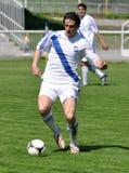 Moravian-Silesian League, footballer Radim Wozniak. FOOTBALL PITCH FRYDEK-MISTEK, CZECH REPUBLIC - MAY 5: Czech footballer Radim Wozniak in football match in vector illustration