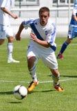 Moravian-Silesian League, footballer S. Molnar. FOOTBALL PITCH FRYDEK-MISTEK, CZECH REPUBLIC - MAY 19: Slovak footballer Slavomir Molnar in football match in vector illustration