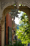 Moravian Star. A Moravian Star decoration hangs above the sidewalk on a street in Bethlehem, Pennsylvania Royalty Free Stock Photography