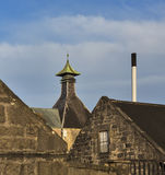 Moray distillery roofs. These are are the roof tops of Longmorn distillery, near Elgin, Moray, Scotland. This is on a sunny winters afternoon stock photo