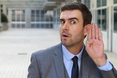 Morbid coworker fascinated with a rumor.  Royalty Free Stock Images