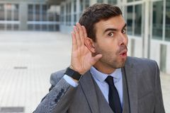 Morbid coworker fascinating with a rumor.  Stock Photography