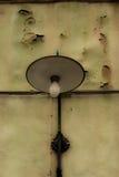 Morbid light. Lamp on an old house Stock Photo