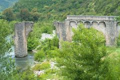 Morbid old bridge over a river ruin. Ponte Nuovo, ruin of a bridge in Corsica, France Stock Images