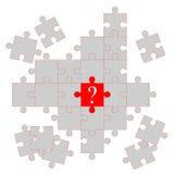 morceau blanc de puzzle avec le rouge au centre Photographie stock