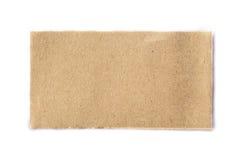 Morceau de Brown de journal déchiré sur le blanc Images stock