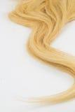 Morceau de cheveux blonds image libre de droits