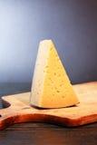 Morceau de fromage Photos stock