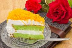 Morceau de gâteau pandan avec la lanière de foi Photographie stock libre de droits