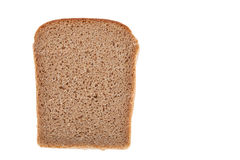 Morceau de pain noir d'isolement sur un fond blanc photographie stock libre de droits