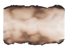 Morceau de papier brûlé d'isolement sur le blanc Image stock
