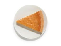 Morceau de tarte de potiron sur une soucoupe Photos libres de droits