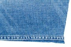 Morceau de tissu bleu-clair de jeans Images libres de droits