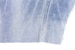 Morceau de tissu bleu-clair de jeans Photo libre de droits