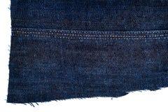 Morceau de tissu bleu-foncé de jeans Photographie stock libre de droits