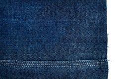 Morceau de tissu bleu-foncé de jeans Photo libre de droits