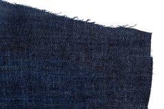 Morceau de tissu bleu-foncé de jeans Images stock