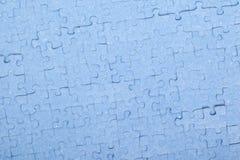 Morceaux bleus reliés de puzzle d'isolement Photo libre de droits