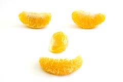 Morceaux d'arrangement orange au visage humain Photographie stock libre de droits