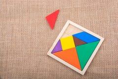 Morceaux d'un puzzle carré de tangram Image stock