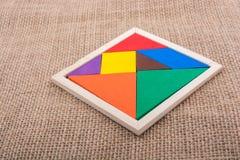 Morceaux d'un puzzle carré de tangram Photo stock