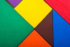Morceaux d'un puzzle carré de tangram Photographie stock libre de droits