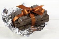 Morceaux de chocolat avec l'arc orange Image stock