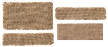 Morceaux de label de tissu de toile de jute, tissu de sac déchiré par correction hessoise rustique photos libres de droits