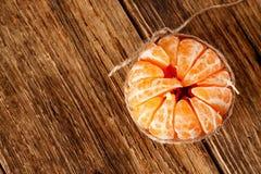 Morceaux de mandarine métallisés par la corde Photographie stock