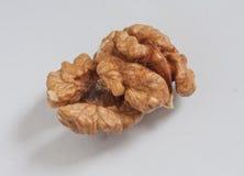 Morceaux de noix sur le fond blanc Photos libres de droits