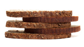Morceaux de pain différent d'isolement sur le fond blanc Photographie stock libre de droits