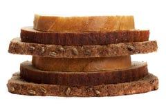 Morceaux de pain différent d'isolement sur le fond blanc Photo libre de droits
