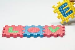 Morceaux de puzzle avec amour de mot Photo stock