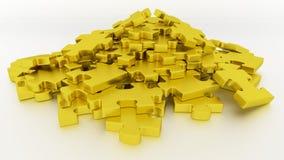 Morceaux de puzzle d'or Photographie stock