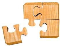 Morceaux de puzzle mécanique en bois Photos stock