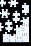 Morceaux de puzzle venant ensemble Photographie stock