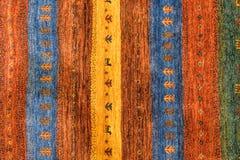 Morceaux de tapis modelés colorés comme milieux Images stock