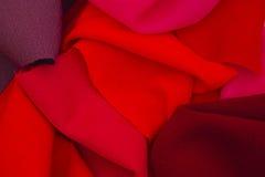 Morceaux de textile rouge images stock
