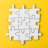 Morceaux vides reliés de puzzle Images libres de droits