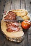 Morcon en spansk korv med bröd och tomaten Fotografering för Bildbyråer