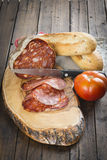 Morcon, a Spanish sausage with bread and tomato Stock Image